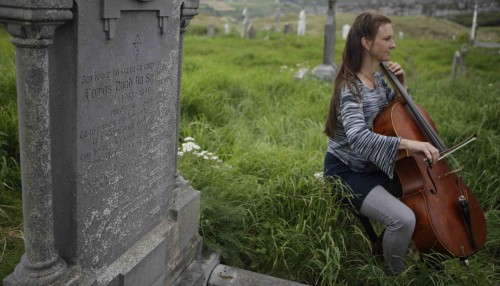 Playing Amhran Na Leabhar (the Song of Books) at the grave of Tomás Rua O Sullivan, the author of the song, in Derrynane.